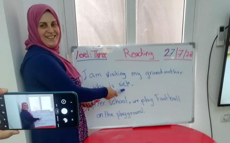 a Jordanian woman stands at whiteboard